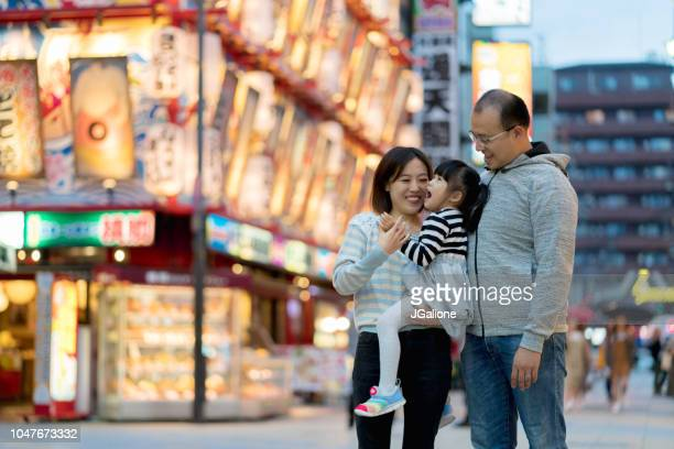Family of tourists exploring a Japanese shopping district