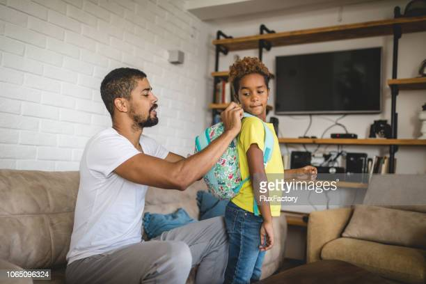 family of two preparing for a first day at school - preparation stock pictures, royalty-free photos & images