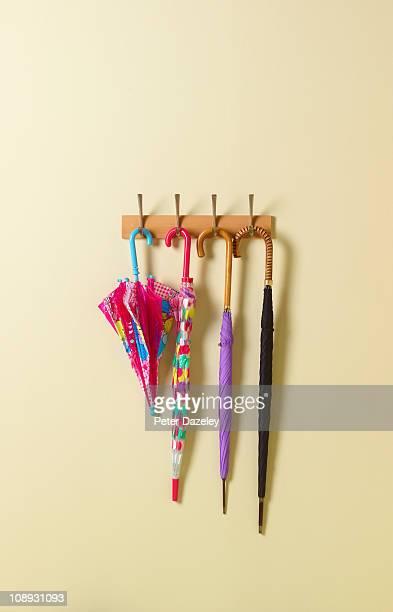 Family of umbrellas on coat rack