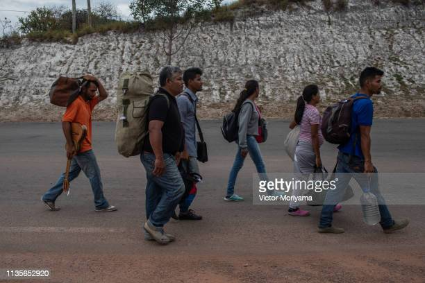 Family of Venezuelan musicians walk to the city of Boa Vista in search of work and better conditions on April 7, 2019 in Pacaraima, Brazil....