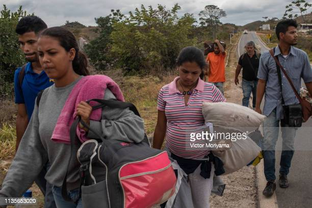 A family of Venezuelan musicians walk to the city of Boa Vista in search of work and better conditions on April 7 2019 in Pacaraima Brazil Venezuelan...