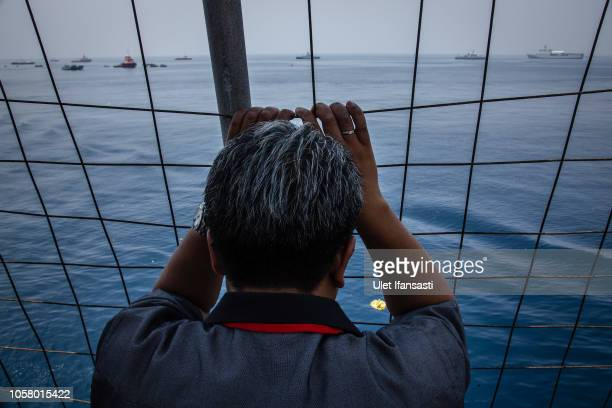 A family of victims of Lion Air flight JT 610 prays on deck of Indonesian Navy ship KRI Banjarmasin during visit and pray at the site of the crash on...