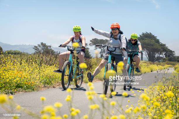 family of women having fun on rental bicycles, california, usa - san mateo county stock pictures, royalty-free photos & images