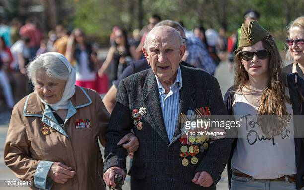 CONTENT] Family of World War II veterans with their grand daughter celebrating Victory Day