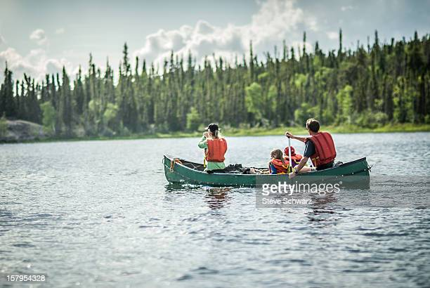 Family on a afternoon canoe trip.