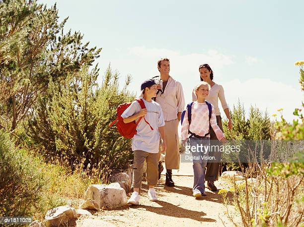 family on a day out walking along a path - travel14 stock pictures, royalty-free photos & images
