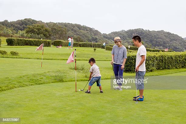Family on a golf course.