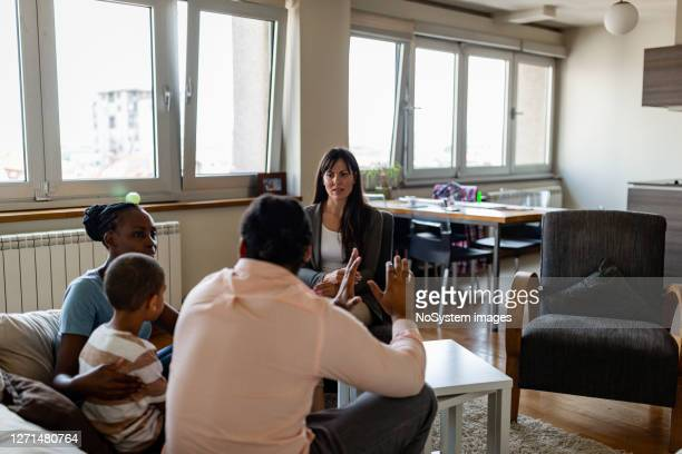 family on a mental health therapy session - divorce stock pictures, royalty-free photos & images