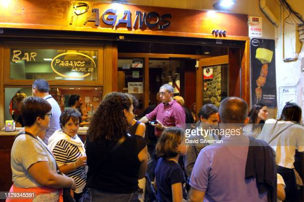A family on a night out passes by Paganos a Pinchos bar that specializes in pincho moruno pork kebabs on September 29 2018 in Logrono Spain Similar...
