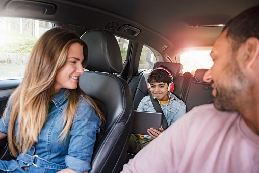 Family on a road trip with boy using tablet - gettyimageskorea