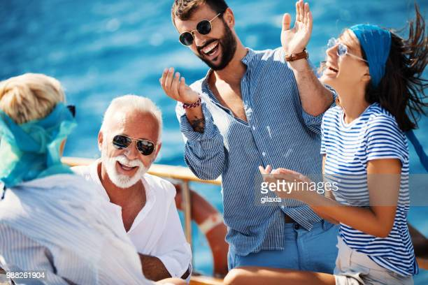 family on a sailing cruise. - cruise stock pictures, royalty-free photos & images