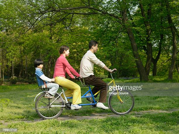 Family on a tandem bike
