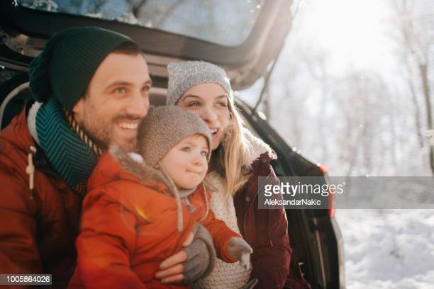 family on a winter road trip - winter stock pictures, royalty-free photos & images