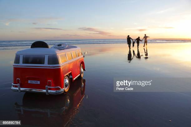 family on beach at sunset with toy car - road trip stock pictures, royalty-free photos & images