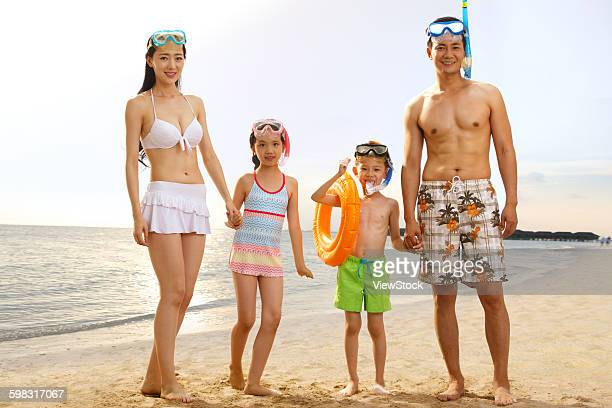 family on beach in swimwear - chinese bikini girls stock pictures, royalty-free photos & images