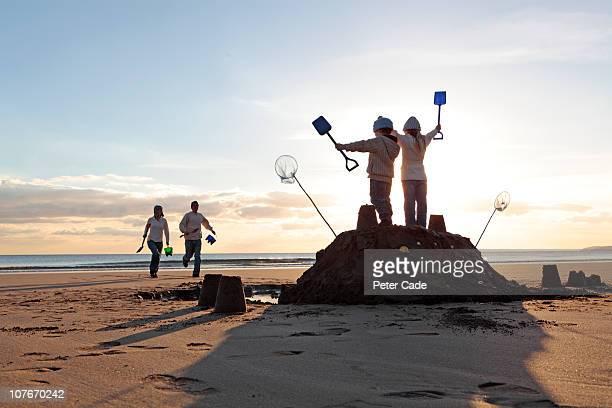 Family on beach in winter