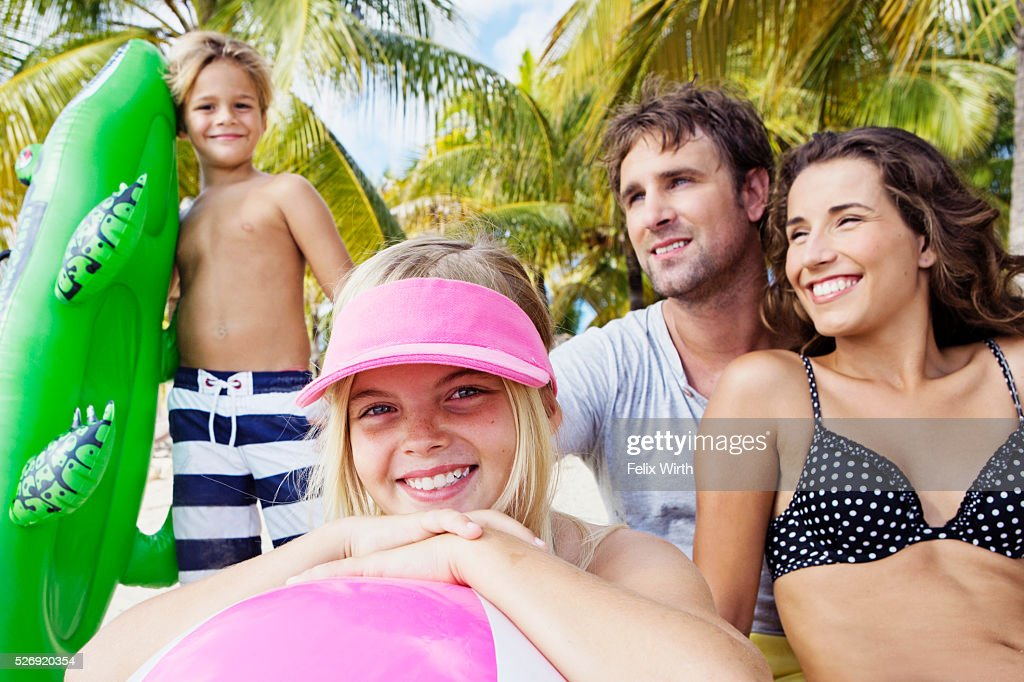Family on beach on summer day : Photo