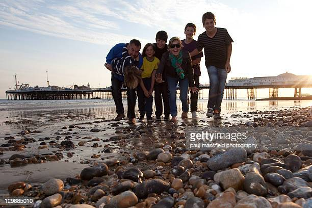 family on beach - brighton beach england stock pictures, royalty-free photos & images