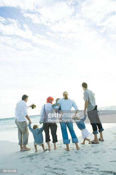 family on beach - obscured face stock pictures, royalty-free photos & images