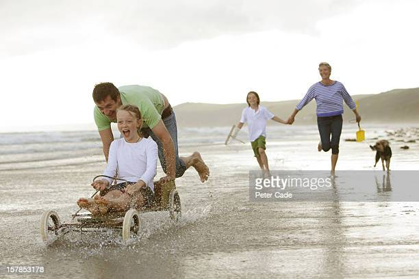 family on beach with home made go-kart - cornish flag stock pictures, royalty-free photos & images