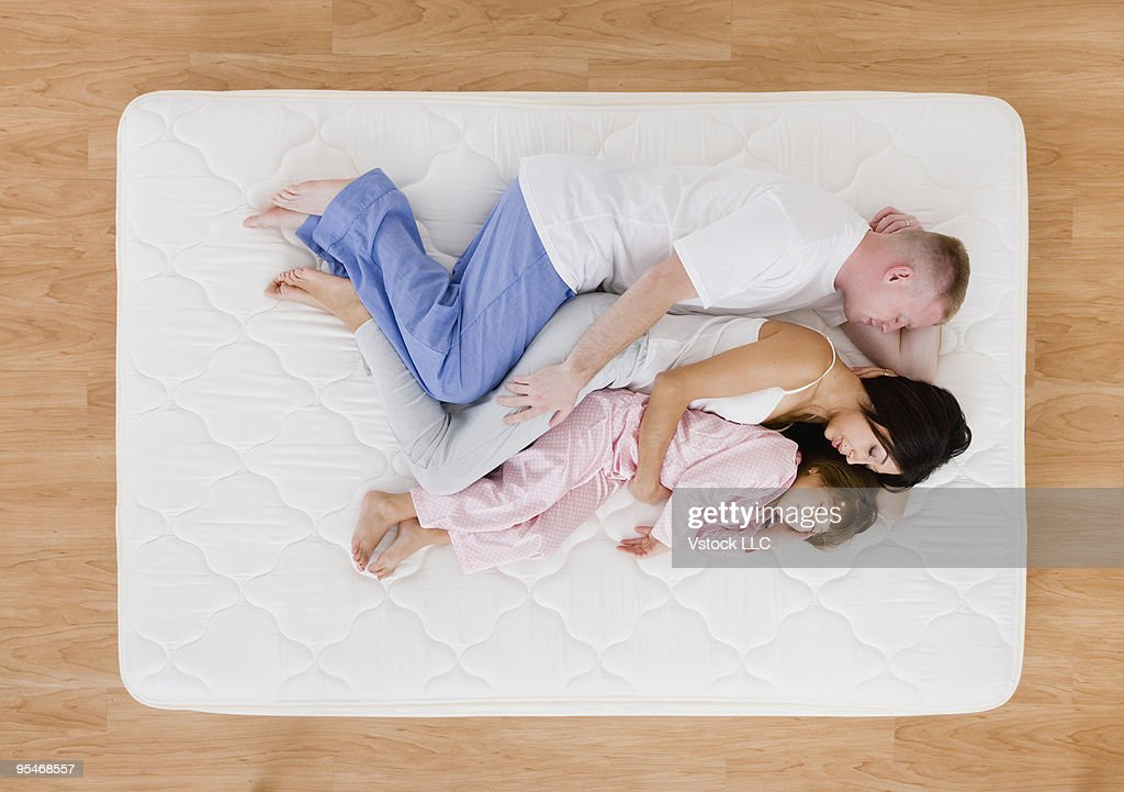 Family on bed : Stock Photo