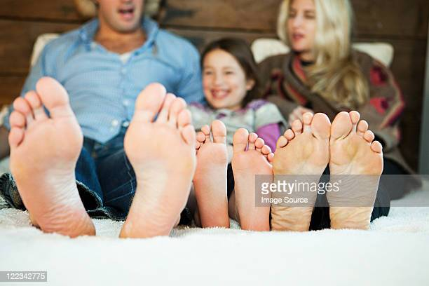 Family on bed with barefeet