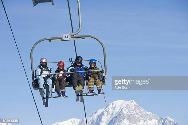 family on chair lift - ski lift stock pictures, royalty-free photos & images