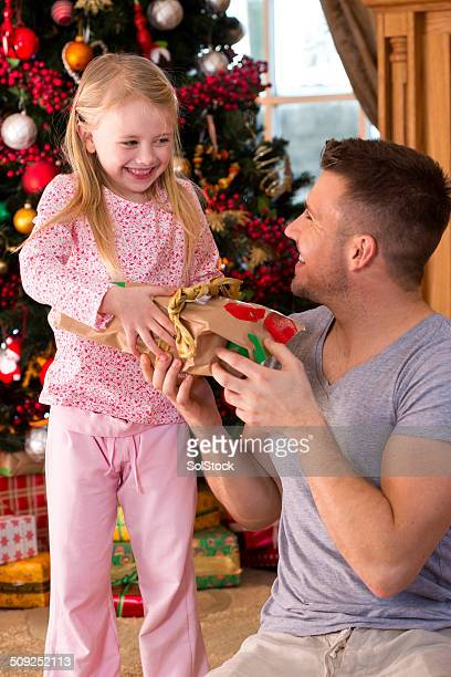 family on christmas day - little girl giving head stock photos and pictures