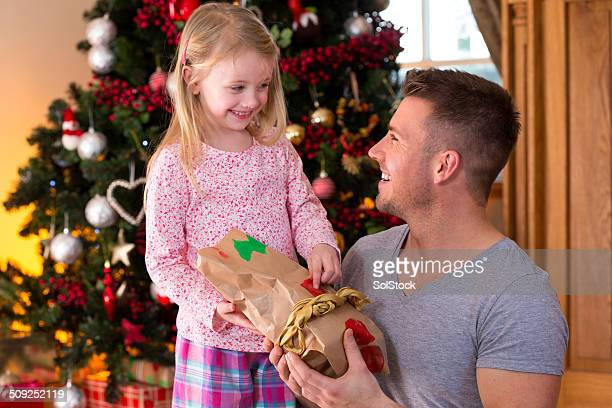 family on christmas day - little girls giving head stock photos and pictures