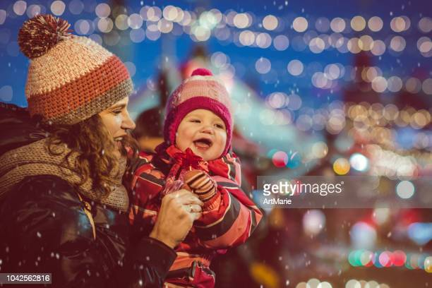 family on christmas shopping - christmas market stock pictures, royalty-free photos & images