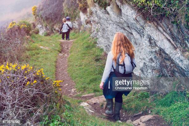 Family on coastal footpath