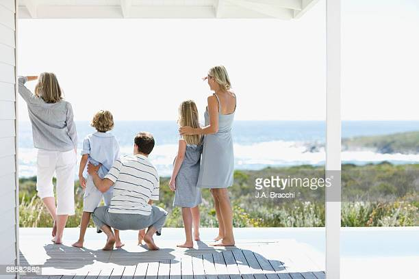 Family on deck looking at ocean