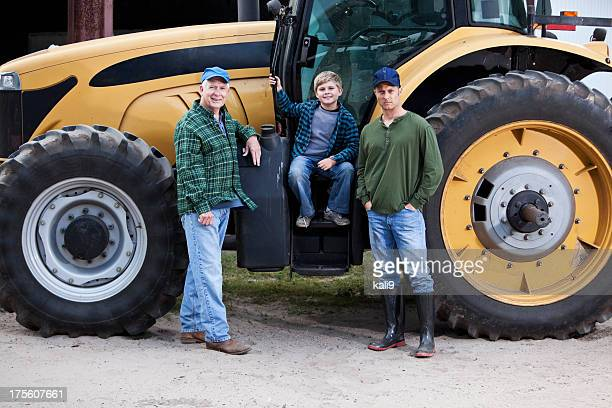 Family on farm tractor