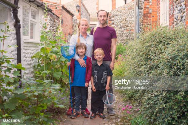 family on holiday - cottage stock pictures, royalty-free photos & images