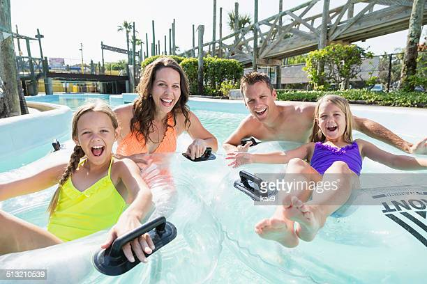 Family on lazy river at water park