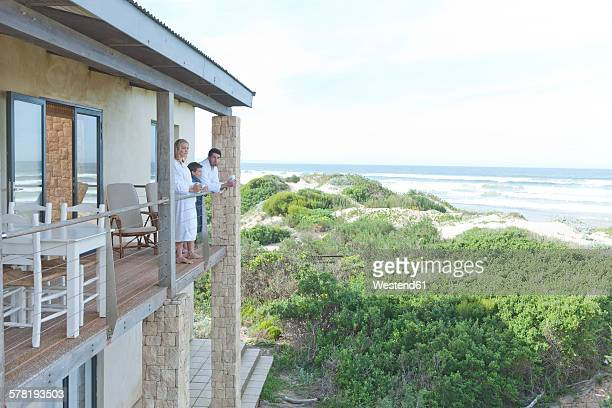 Family on patio of beach house