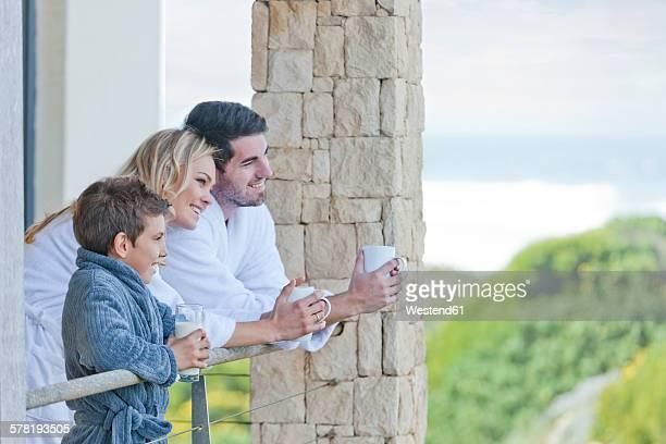 Family on patio of beach house