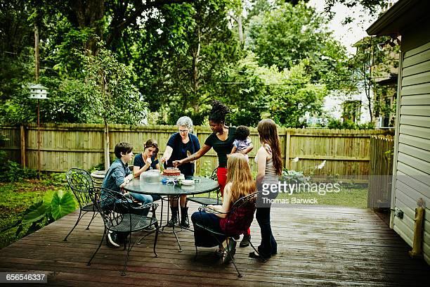 Family on patio of home celebrating birthday