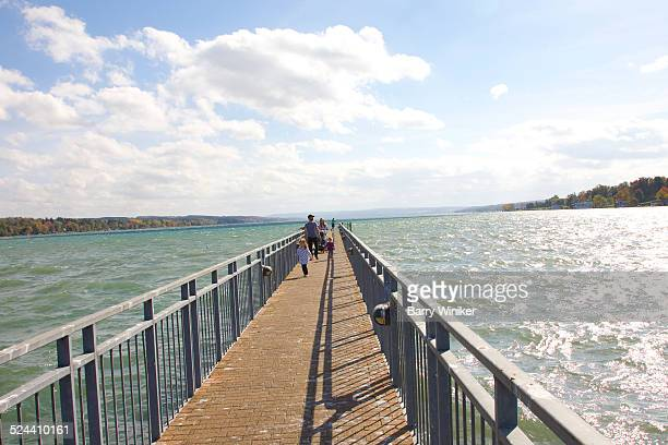 family on pier, finger lakes - skaneateles lake stock pictures, royalty-free photos & images