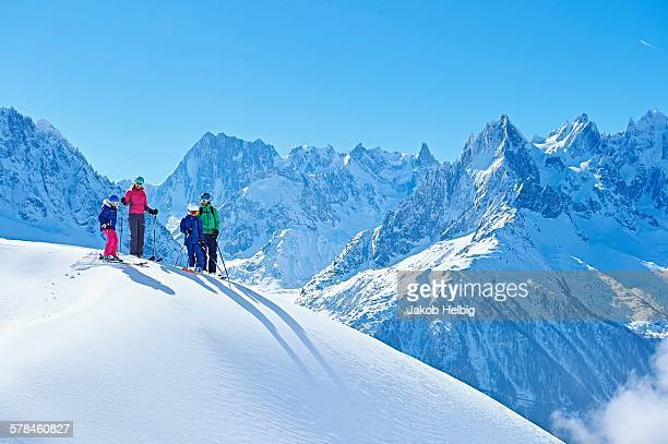 family on ski trip, chamonix, france - ski holiday stock photos and pictures
