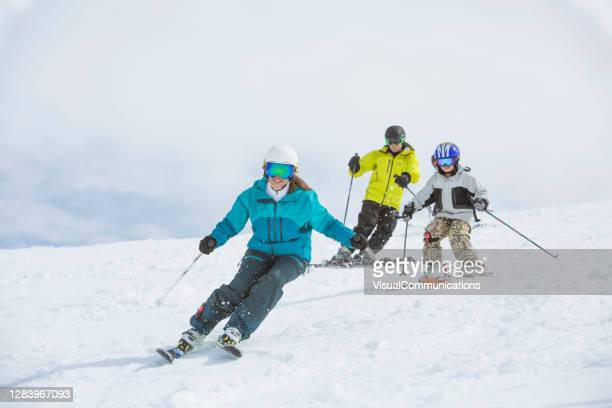 family on ski vacation in whistler, bc, canada. - skiing stock pictures, royalty-free photos & images