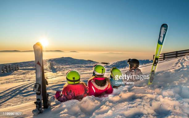 family on ski vacation - winter sport stock pictures, royalty-free photos & images
