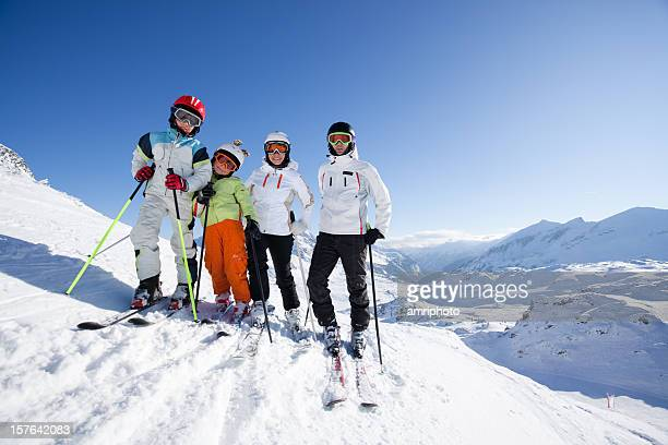 family on skiing holiday in the mountains