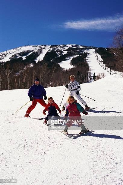 Family on skis, in 'stopping' position