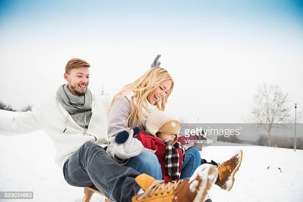 Family on sledding