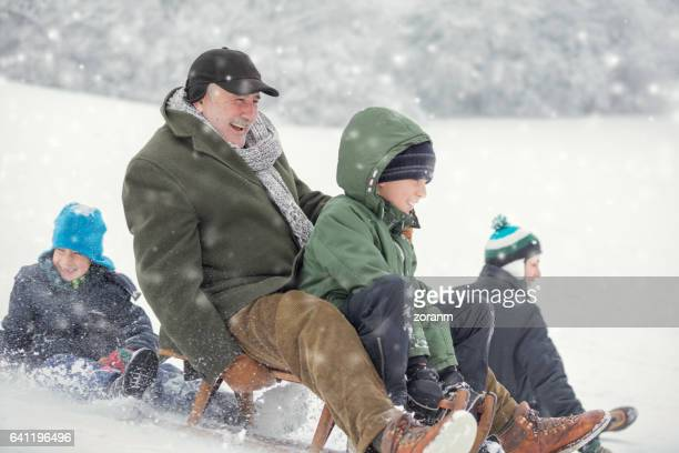 family on snow - ski holiday stock photos and pictures