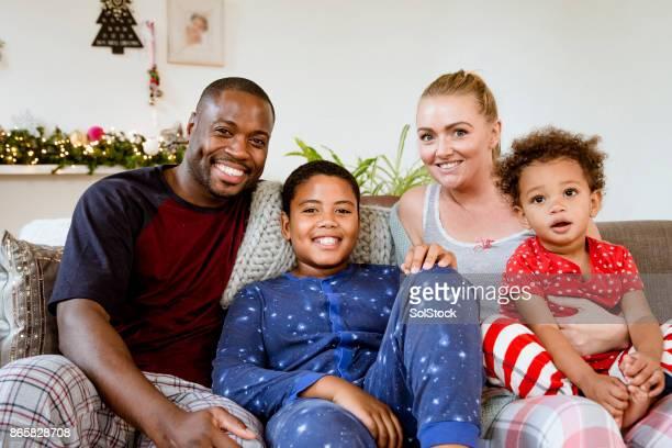 Family on Sofa over Christmas