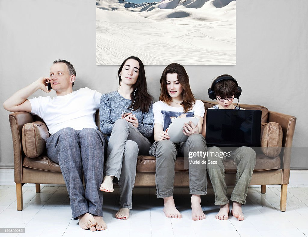 Family On Sofa : Stock Photo