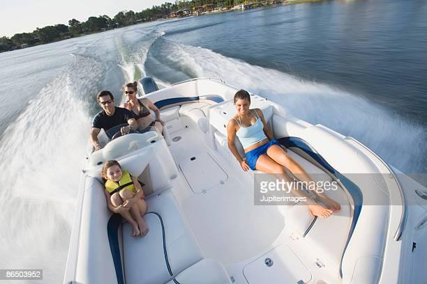 Family on speedboat