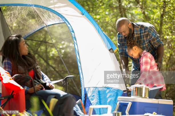 Family On Summer Or Autumn Vacation Camping In Forest